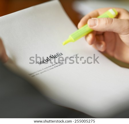 Social media definition as a shallow depth of field close-up composition of a man in a business suit working with the text - stock photo