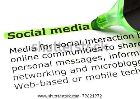 Social media highlighted in green with felt tip pen. - stock photo