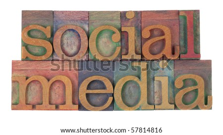 social media in vintage wooden letterpress printing blocks, stained by color inks, isolated on white
