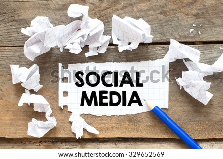 Social media. Note with social media on the wooden background with pen - stock photo