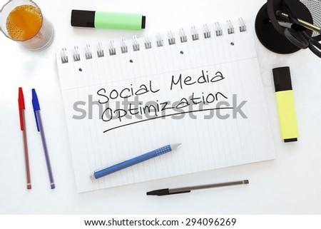 Social Media Optimization - handwritten text in a notebook on a desk - 3d render illustration. - stock photo