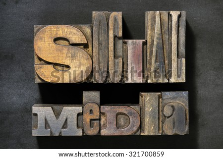 social media phrase made from mixed wooden letterpress type  - stock photo