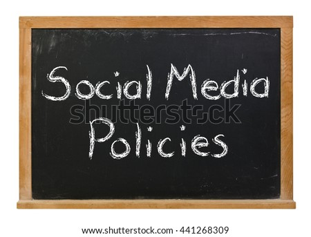 Social media policies written in white chalk on a black chalkboard isolated on white