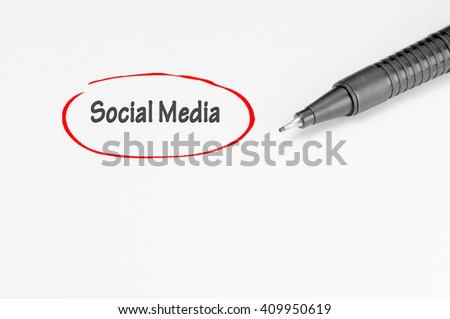 Social media written on white paper - Business Concept
