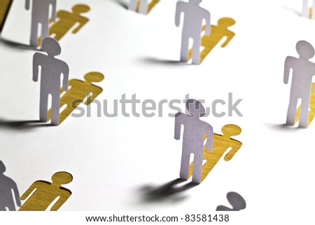 Social Network concept : close up of people cut out of paper on wooden table - stock photo