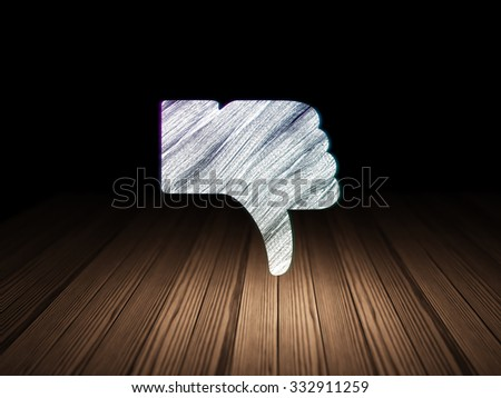 Social network concept: Glowing Thumb Down icon in grunge dark room with Wooden Floor, black background - stock photo