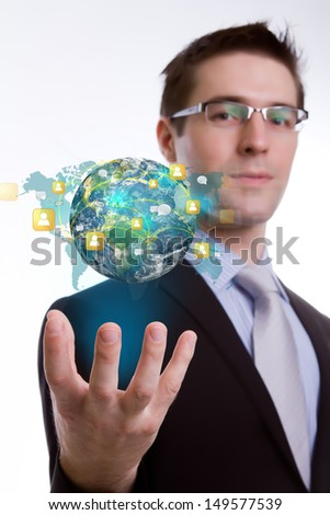 Social Network concept :young business man holding earth of social network (Elements of this image furnished by NASA) - stock photo