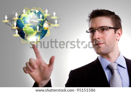 Social Network concept : young business man point earth of social network - stock photo