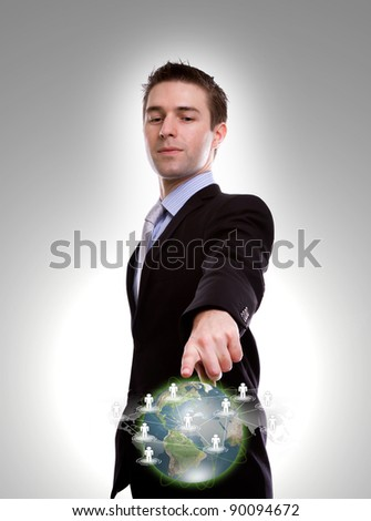 Social Network concept : young business man point to social network and world map - stock photo