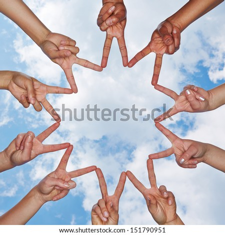 Social network made of many hands in a group under a sky with clouds - stock photo