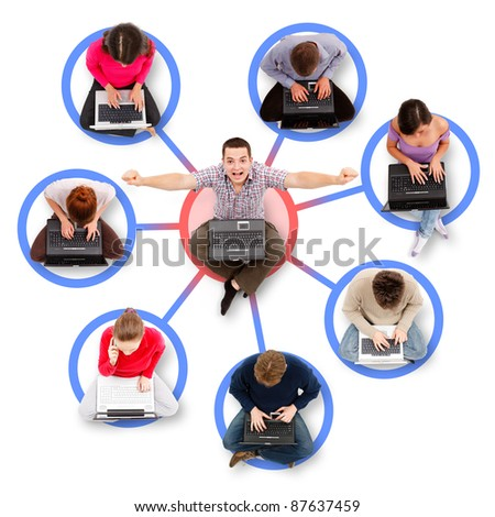 Social network members sitting with their laptop computers around a successful, happy man - stock photo
