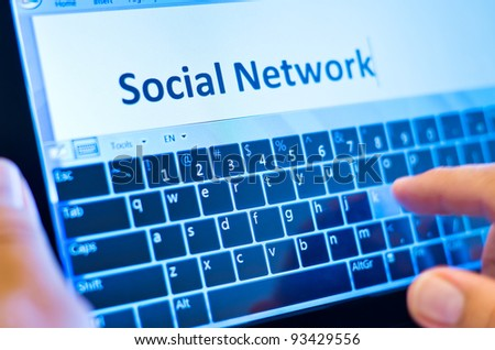 social network on tablet-pc with finger on virtual keyboard - stock photo
