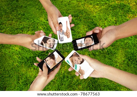 social network on the smart phone of young group - stock photo