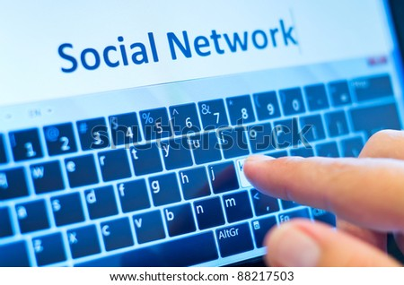 social network on touch-screen tablet-pc with finger on virtual keyboard - stock photo