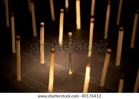 social network: the burnt down match - stock photo