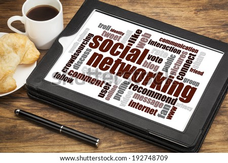 social networking word cloud on a digital tablet  with a cup of coffee - stock photo