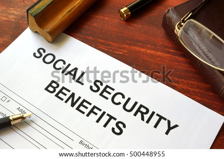 Social security benefits form, book and glasses.