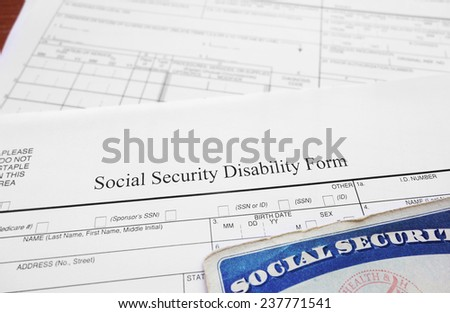 Social Security Disability form and Social Security card                                - stock photo