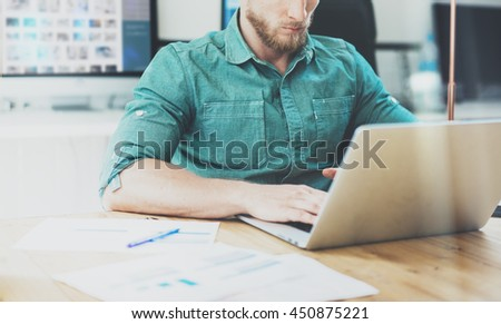 Social Trading Online Public Relations Director Analyze Reports.Guy working wood table Modern Interior Office.Businessman Work Coworking Studio.Using Digital Laptop.Blurred Background.Business Startup - stock photo