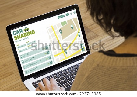 social travel concept: car sharing software on a laptop screen. Screen graphics are made up. - stock photo