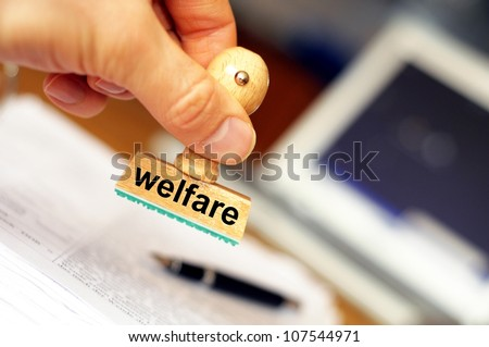 social welfare concept with stamp in office or bureau and copyspace - stock photo