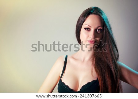 Socialite portrait, looking at the camera and flirting with the camera - stock photo