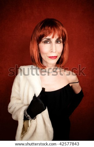 Socialite with fur coat and brassy red hair - stock photo