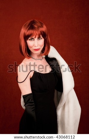 Socialite with white coat and brassy read hair - stock photo