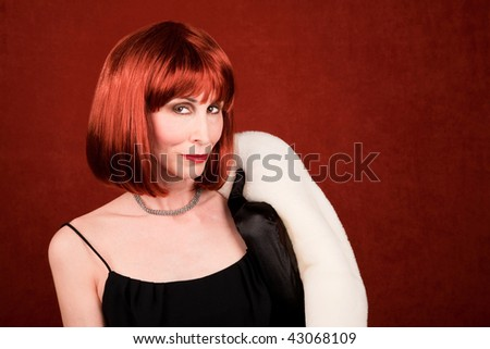 Socialite with white coat and brassy red hair - stock photo