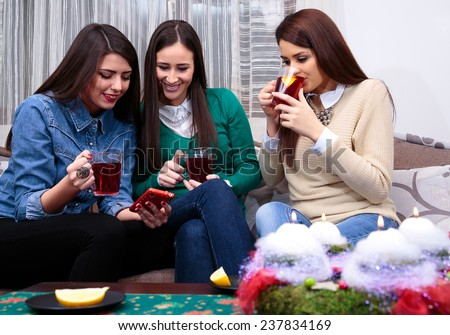 socializing friend for Christmas with a cup of tea/cup of tea - stock photo