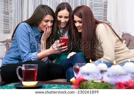 socializing friend for Christmas with a cup of tea/friend for Christmas with a cup of tea - stock photo
