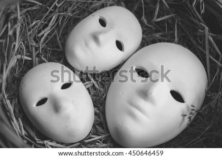 Society is full of mask,black and white picture,grain,noise,soft focus,abstract background - stock photo