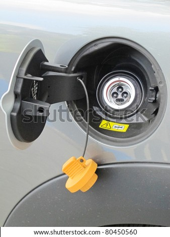 socket of an electric car ready for charging - stock photo
