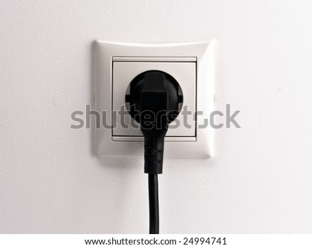 socket with black fork - stock photo