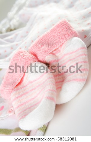 Socks and other clothing for baby girl. - stock photo