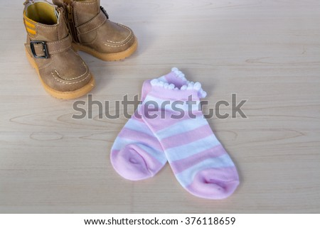 Socks colorful. Set of socks. With brown boots children