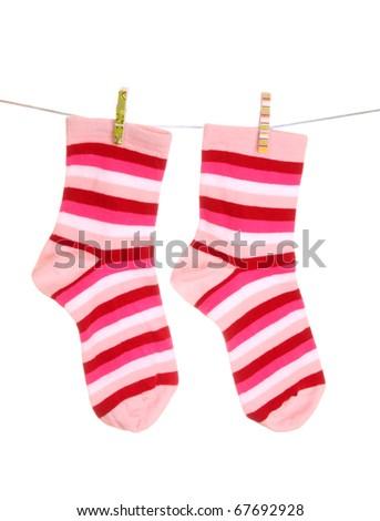 Socks hanging isolated on white - stock photo
