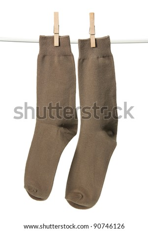Socks with Pegs on White Background - stock photo