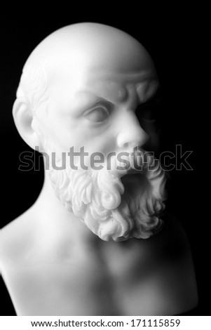 Socrates lived in Athens (470 BC - 399 BC) was a Greek Athenian philosopher. It is one of the founders of Western philosophy.  White marble bust of him. - stock photo