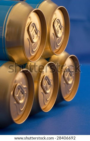Soda (beer) cans pyramid. Selective focus - stock photo