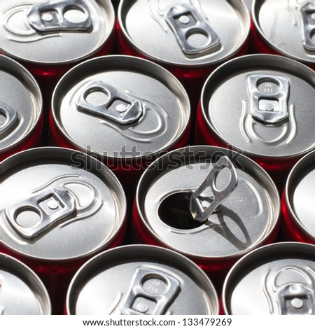 Soda cans. One opened. - stock photo