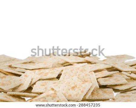 Soda crackers bottom border isolated on white background - stock photo