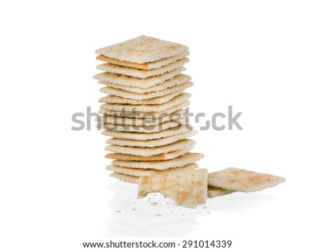 Soda crackers single stack half eaten isolated on white background - stock photo