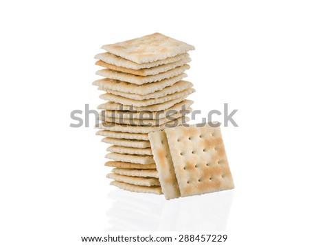 Soda crackers single stack isolated on white background - stock photo