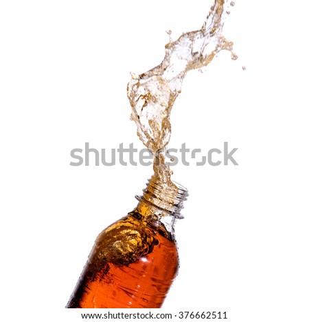 Soda splash out of bottle on white background. - stock photo