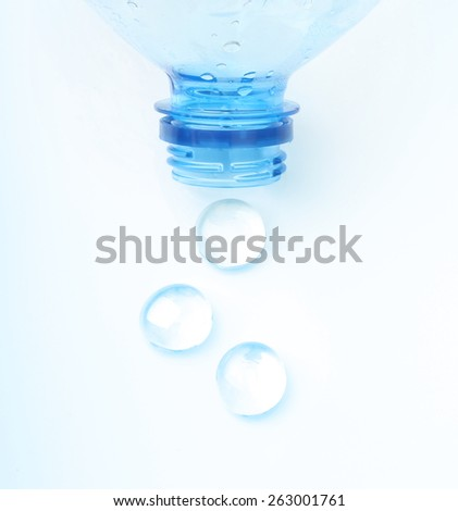 Soda water bottle with water drops isolated on white - stock photo