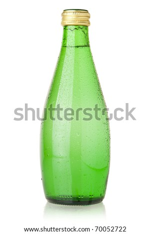 Soda water in glass bottle with drops. Isolated on white - stock photo