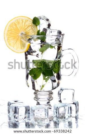 soda water with ice and lemon - stock photo