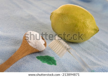 Sodium bicarbonate and Lemon  used for cleaning metal surfaces, dishes and clothes - stock photo