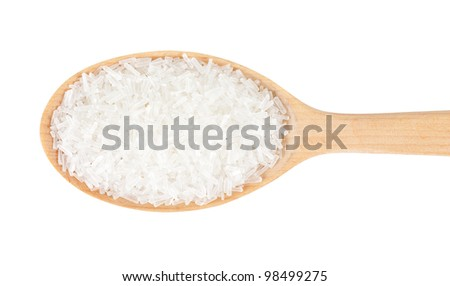 Sodium glutamate in a wooden spoon. isolated on a white background - stock photo